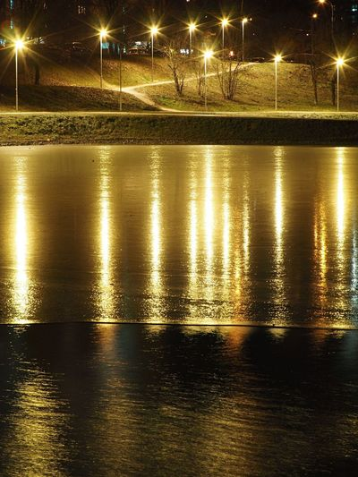 Reflection of illuminated lights on water