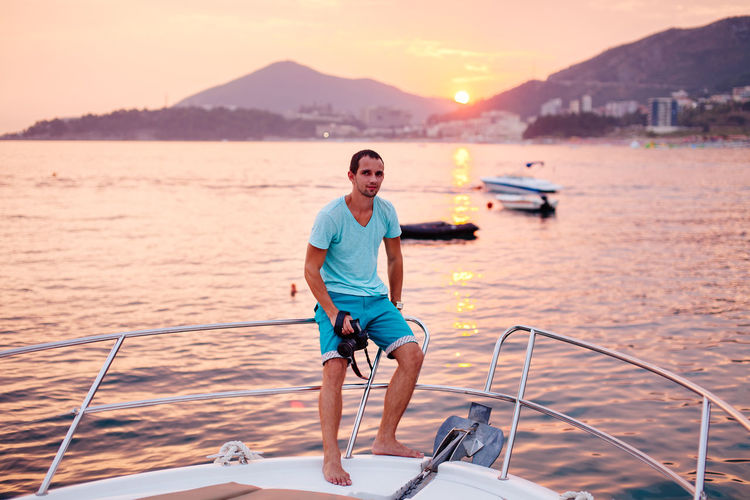 man yachting and relax on boat with camera. photographer on yacht Camera Camera - Photographic Equipment Man Relaxing Sunset_collection Travel Traveling Travelling Handsome Male Photo Photographer Sailing Ship Sunset Travel Destinations Yacht Yachting