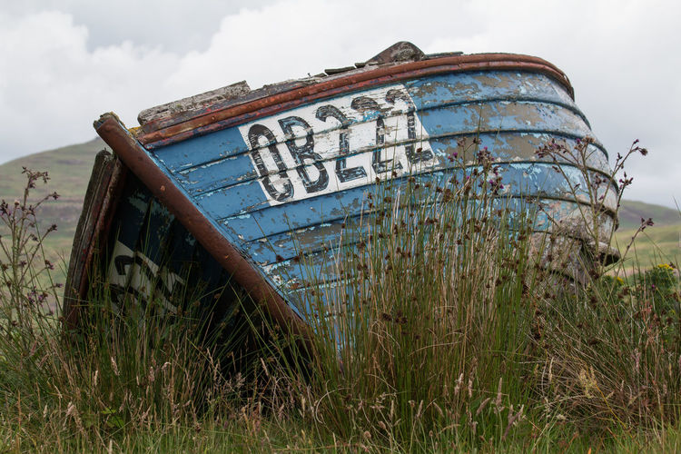 Nature Land Cloud - Sky Outdoors Damaged Rusty Text Day Grass Ruined Used Retro Boat Boats Ob222 Scotland IsleofMull EyeEmNewHere
