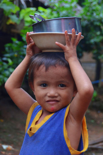 HEAD Philippines Rural Rural Scenes Tourist Travel Boys Childhood Cute Cutlery Fed Food Happiness Lifestyles One Person Portrait Real People Smiling Tourism