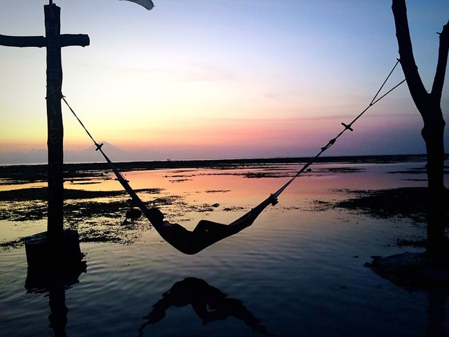 Hamak Sunset Relaxing Sky Colors Sun Gili Trawangan Island Paradise INDONESIA Blue Blue Sky Pink Reflection Chilling Capturing Freedom Sunset_collection Sunset Silhouettes Nature's Diversities People And Places Visual Creativity