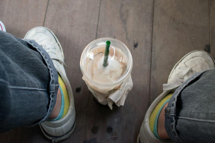 Milkshake between shoes