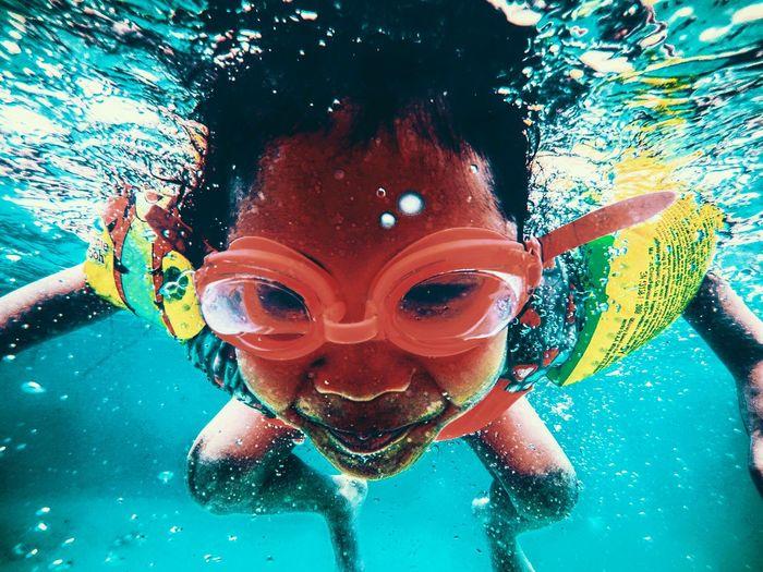 Portrait Of Boy Swimming Underwater