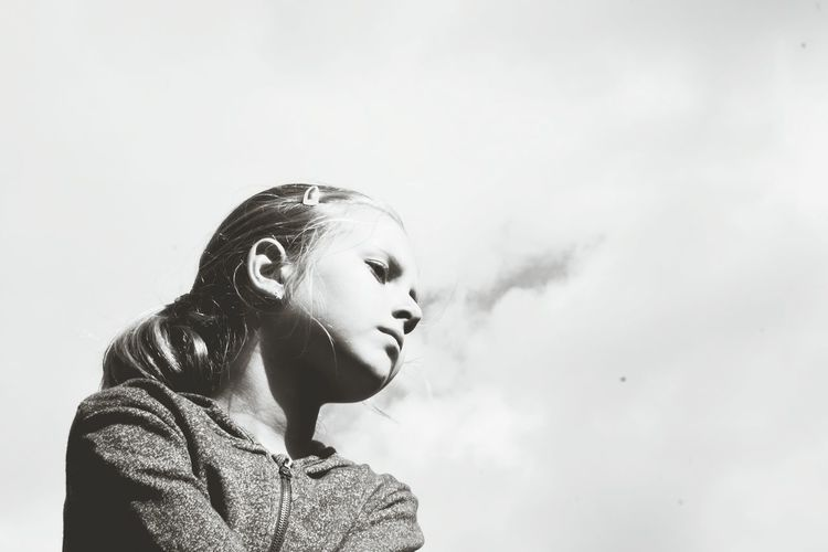 Close-Up Of Young Girl Against Sky