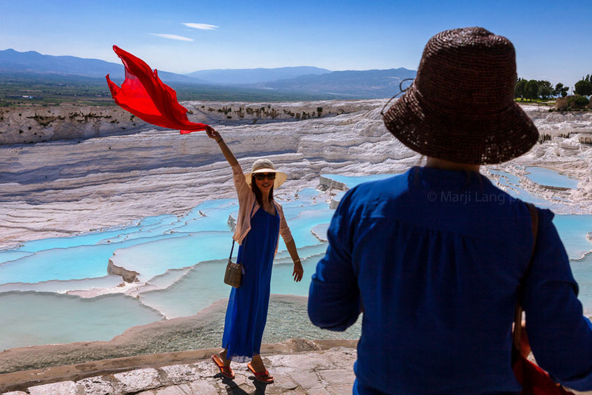Tourists by the natural pools of Pamukkale, Turkey. Beauty In Nature Blue Casual Clothing Day Enjoying Life Hats Landscape Leisure Activity Nature Non-urban Scene Outdoors Pamukkale Pool Rock Formation Scenics Sky Summer Feel The Journey Tourism Tourist Travel Destinations Turkey Vacations Water Women