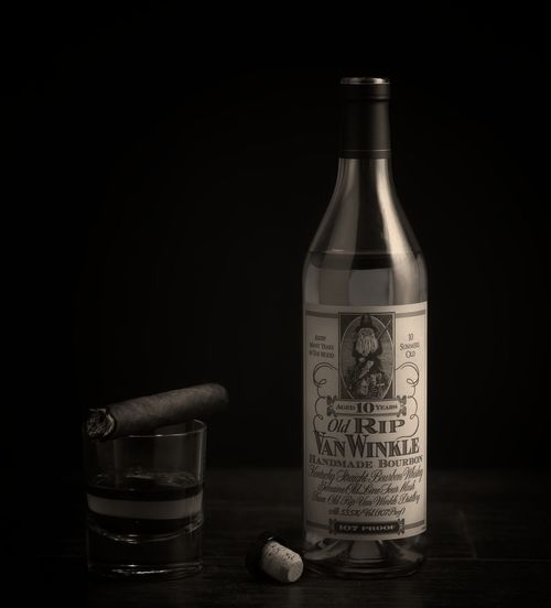 Rip Van Winkle Alcohol Black Background Bottle Cigar Close-up Container Copy Space Cork - Stopper Drink Food And Drink Glass Glass - Material Label No People Refreshment Still Life Studio Shot Table Wine Bottle