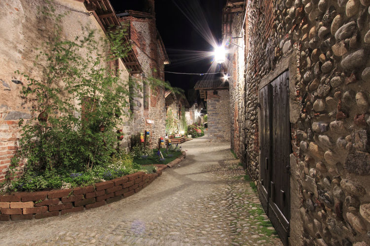 Candelo, Biella - May 4, 2016: View form the inside of the Medieval village of Ricetto di Candelo in Piedmont, used as a refuge in times of attack during the Middle Age. Alley Architecture Biella Building Built Structure Candelo Candelo In Fiore City Diminishing Perspective Empty Footpath Illuminated Italy Long Medieval Village Narrow No People Outdoors Pathway Residential Building Residential Structure Ricetto Di Candelo  The Way Forward Vanishing Point Walkway