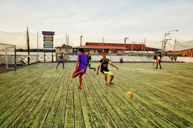Footsal Playing Soccer Football Sky Nature Real People Group Of People Day Men Architecture Outdoors Child People Togetherness