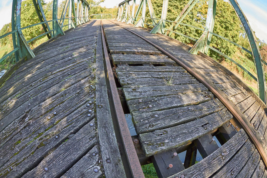 Railway Bridge Abandoned Architecture Boardwalk Bridge Close-up Day Growth High Angle View Metal Mode Of Transportation Nature No People Obsolete Old Outdoors Plant Railing Railway Railway Bridge Track Transportation Wood - Material