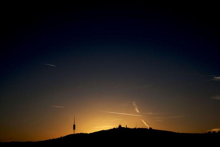 Tibidabo at sunset, Barcelona, Spain. Landmark Landscape Mountain No People Sacred Hear Hear Of Jesus Christ Churc Scenics Silhouette Sky Skyline Sunset Telecommunications Tower Tibidabo Tranquil Scene Vapor Trail