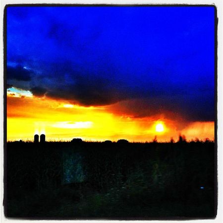 Drive-by Sunset. #quebec Webstagram Igcanada Sunset Qc IPhoneography Igvermont Travel Igvt Driveby Usa_border Quebec Canada_usa_border Farm Pikeriver Silos Iphoneonly Bedford Instamood Sunsetporn Farnham Instagood Instagramhub