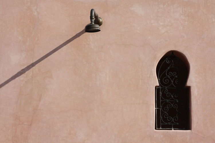 Shower Head Mounted On Wall By Window Of Riad