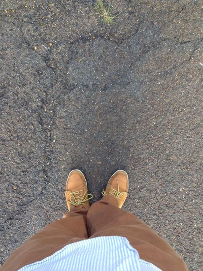 Low section view of person standing on road