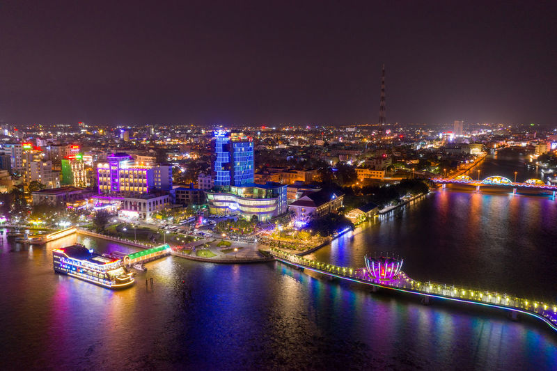 High angle view of illuminated bridge over river at night can tho city
