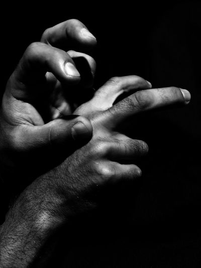 Black Background Close-up Cropped Dark Detail Focus On Foreground Holding Human Finger Lifestyles Part Of Person Selective Focus Showing Studio Shot Touching Unrecognizable Person Fine Art Photography Monochrome Photography Resist Break The Mold Visual Creativity My Best Photo