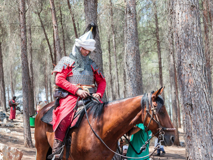 Tiberias, Israel, July 01, 2017 : Participants in the reconstruction of Horns of Hattin battle in 1187 depicting Saladin sits on a battle horse in the camp before the campaign near TIberias, Israel 1187 Army Battle Crusaders Defeat Equipment Field Guy De Lusignan Hattin Heat Heritage History Horn Horseman Israel Jerusalem KINGDOM Muslims Palestine Religion Saladin Templars Victory War Weapons