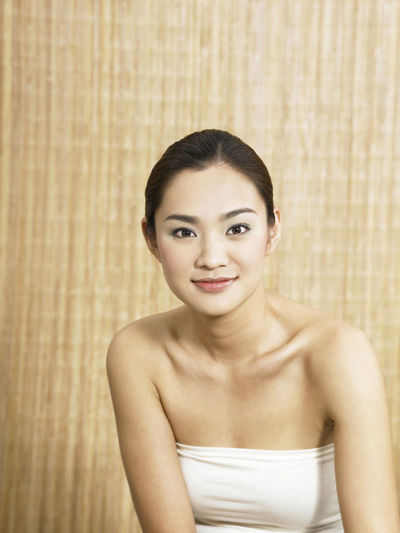 beauty and health concept Adult Adults Only Bamboo Background Beautiful Woman Beauty Beauty Spa Chinese Close-up Day Front View Indoors  Lifestyles Looking At Camera One Person One Young Woman Only People Portrait Real People Standing Young Adult Young Women