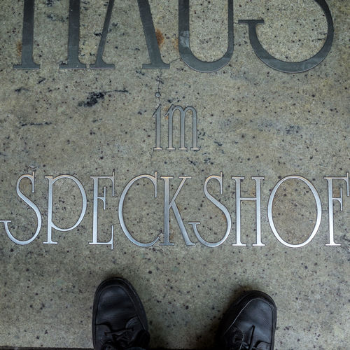Floortrait with symbol Black Color Blick Nach Unten Close-up Day Floortraits Foot Shot Footwear Fussboden Fußbild Human Foot Information Information Sign Lifestyles Look Down Low Section Outdoors Part Of Person Personal Perspective Perspective Standing Standpunkt Text