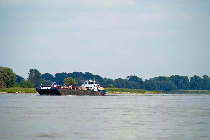 Barge in elbe river against sky