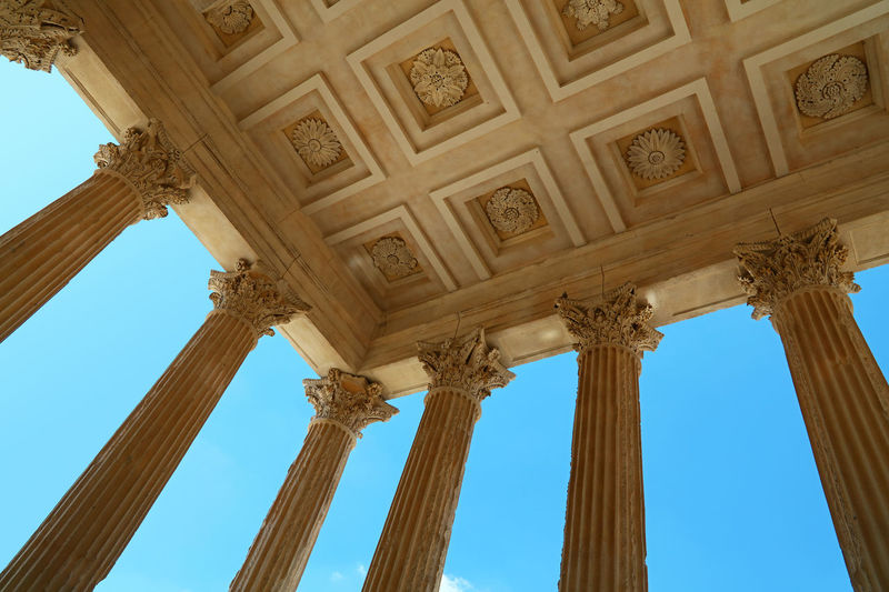 "Maison Carrée (French for ""square house"") is an ancient building in Nîmes, one of the best preserved Roman temple facades to be found in the territory of the former Roman Empire Low Angle View Architecture History The Past Architectural Column Built Structure No People Travel Destinations Day Ceiling Sky Tourism Travel Ancient Building Exterior Architectural Feature Ornate Neo-classical Ancient Civilization Architecture And Art Roman Temple Antique Provence Famous Place 17.62°"
