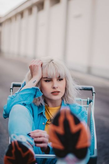 EyeEm Selects One Person Women Portrait Adult Lifestyles Blond Hair Young Adult Looking At Camera Front View Clothing Hair Fashion Real People Sitting Young Women Beauty Dyed Hair Beautiful Woman Body Part Hairstyle