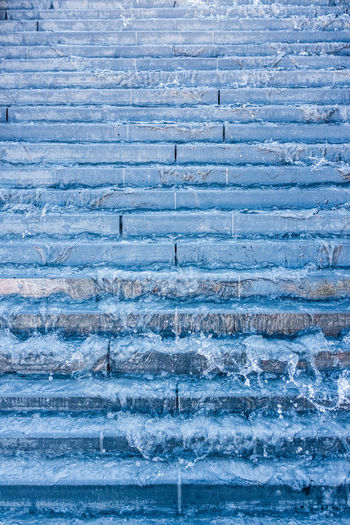 Metallic blue stairs and freezing motion Architecture Backgrounds Beautifully Organized Blue Built Structure Close-up Day Falling Water Full Frame Gravity Metallic Blue No People Outdoors Pattern Stairs Stairs_collection Texture Urban Exploration Urban Geometry Water Waterfall