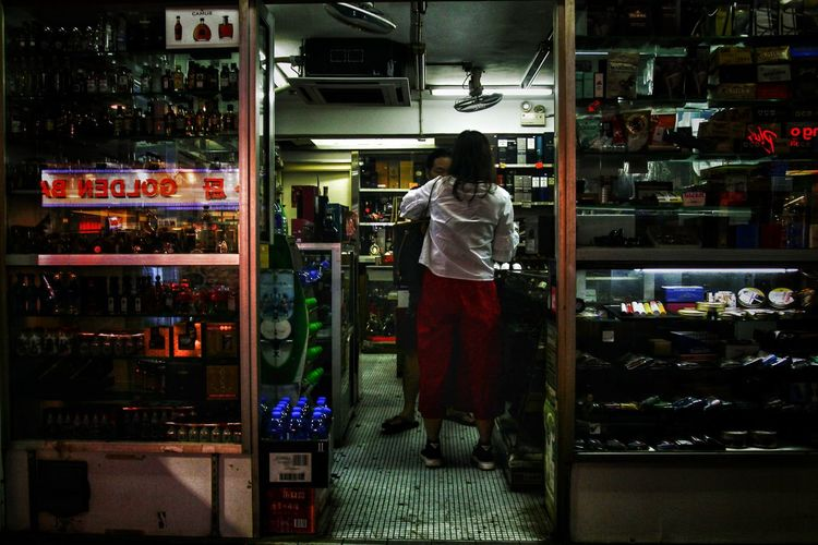 Liquor Store Liquor Alcohol Store Woman Old Street Vintage Style Hong Kong Vivid Nostalgia Street Urban Nightphotography Full Length Business City Illuminated Business Finance And Industry Store Retail  Architecture Store Window Window Display Display Shop Shelves Window Shopping Retail Display Mainframe For Sale