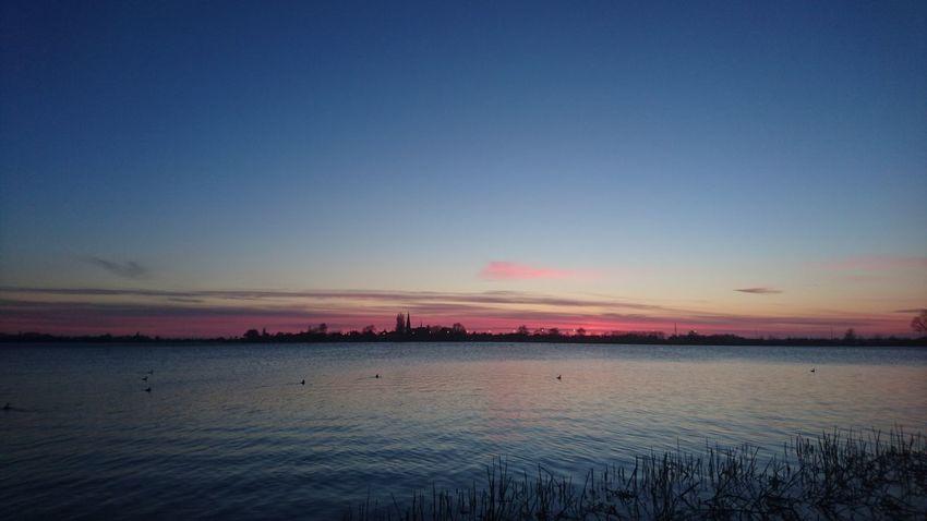 Winter sunset over Lake Langeraar Lake Langeraar Boating Winter Nieuwkoop Zuid Holland Sunset Sky Outdoors No People Beach Scenics Beauty In Nature Horizon Over Water Water Travel Destinations