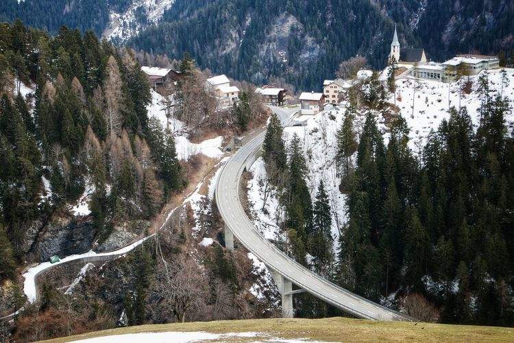High angle view of road amidst trees during winter
