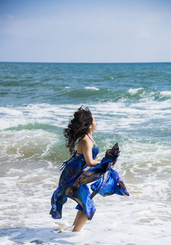 Model: Vanessa Hidalgo Adult Adults Only Beach Butterfly Curly Hair Horizon Over Water Human Butterfly Leisure Activity Musical Instrument Nature One Person One Woman Only One Young Woman Only Only Women Outdoors People Vanessa Hidalgo Young Adult Art Is Everywhere Live For The Story