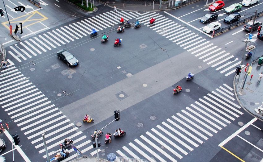 High Angle View Of Scooters On Road
