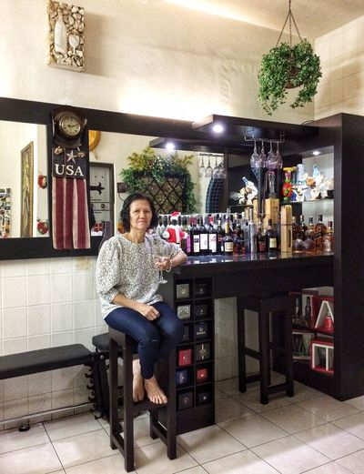 One Person Looking At Camera Small Business Full Length Portrait Business My Best Photo Casual Clothing Adult Smiling Sitting Real People Seat Happiness Bar Counter