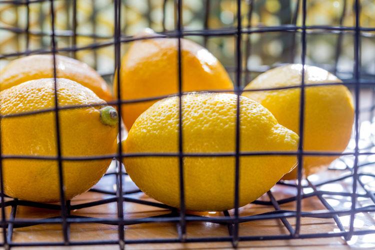 Close-up of yellow lemons in basket