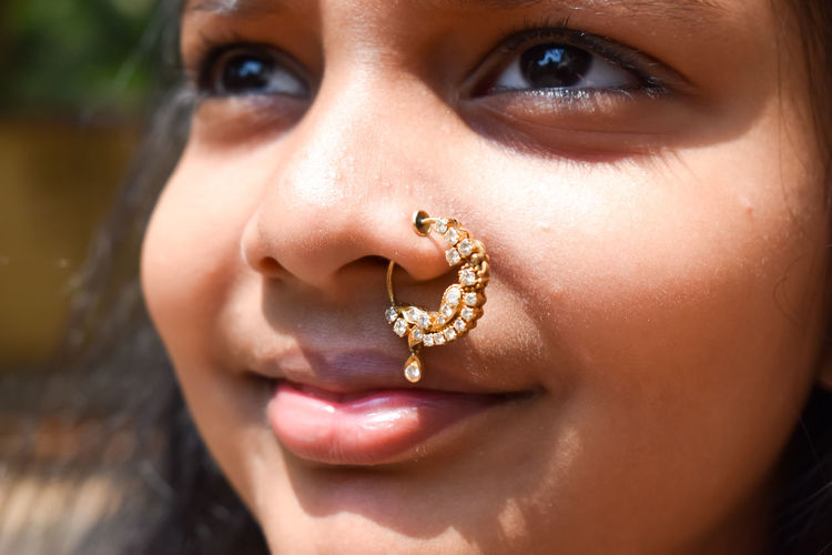 Close-up portrait of girl wearing nose ring