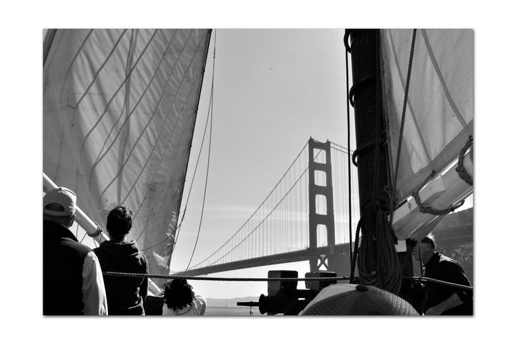 Hoisting The Sails 4 Aboard The Alma 1869 80 Ft. Scow Schooner Sailing San Francisco Bay Golden Gate Bridge Bridge Tower & Span Deck Hands For A Day Bnw_summer Memory's Bnw_friday_eyeemchallenge A Day On The Bay Ships Rigging Canvas Sails Mast Ropes Peope On Board Monochrome Lovers Monochrome Shadows Gin Pole Black & White Black & White Photography Black And White Black And White Collection  Nautical Vessel Wooden-hulled Flat-bottomed Sailing Ship