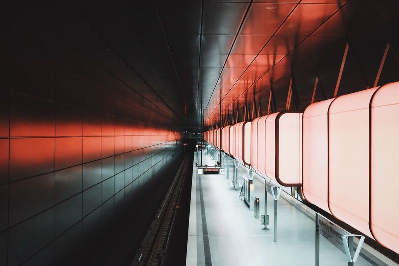 Empty illuminated subway station