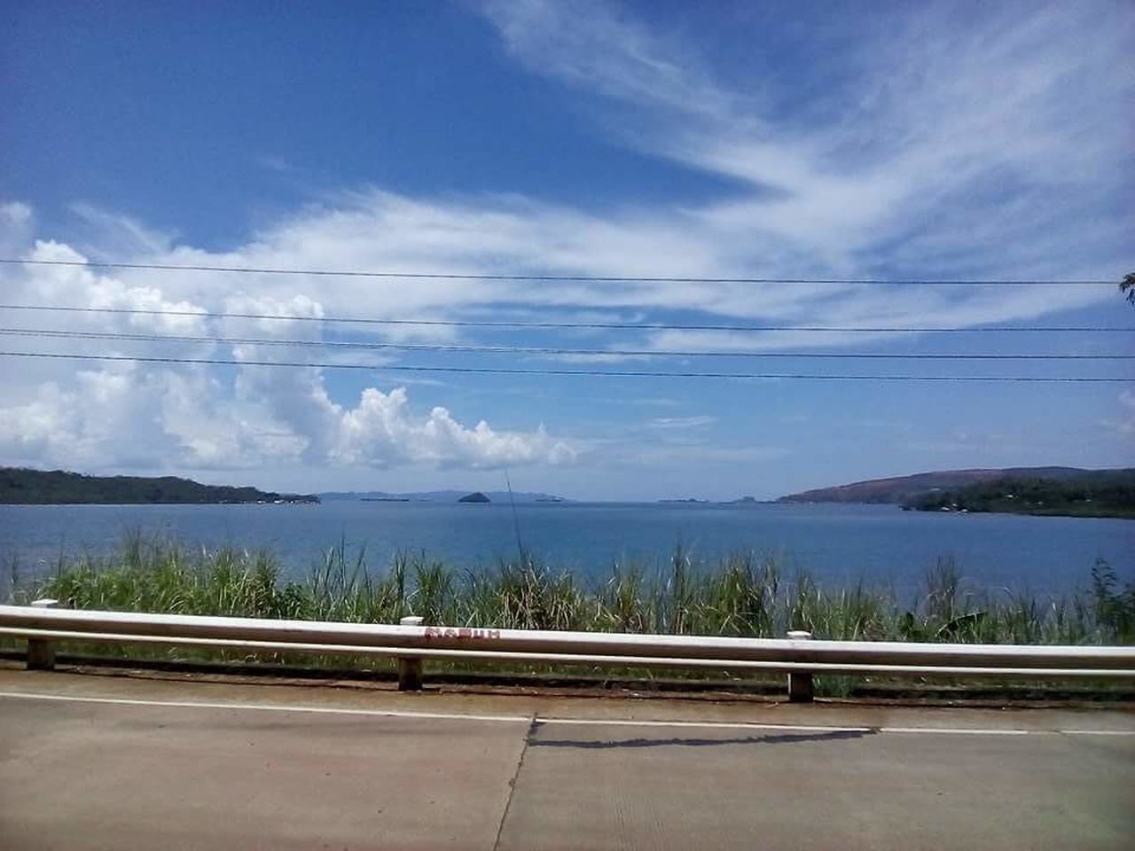 sky, scenics, cloud - sky, nature, tranquility, beauty in nature, day, water, no people, tranquil scene, outdoors, transportation, road, mountain, sea, tree