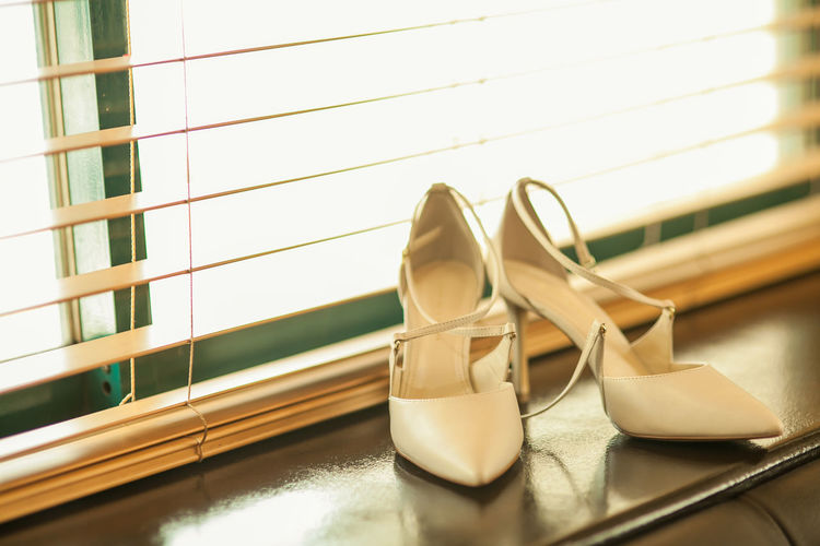 Close-up of high heels on window sill