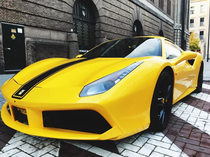 Ferrari ⚡️ City Street Car Architecture Mode Of Transportation Yellow Motor Vehicle Land Vehicle Transportation Built Structure Building Exterior Taxi No People Day Outdoors Yellow Taxi Stationary Footpath Parking Cobblestone