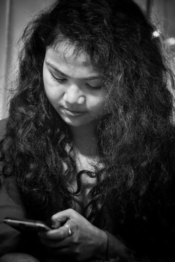 Curly Hair Blackandwhite EyeEm Selects Girl With Phone Young Women Beautiful Beauty No Makeup One Person Indoors  Childhood People Happiness Real People Close-up Portrait Day