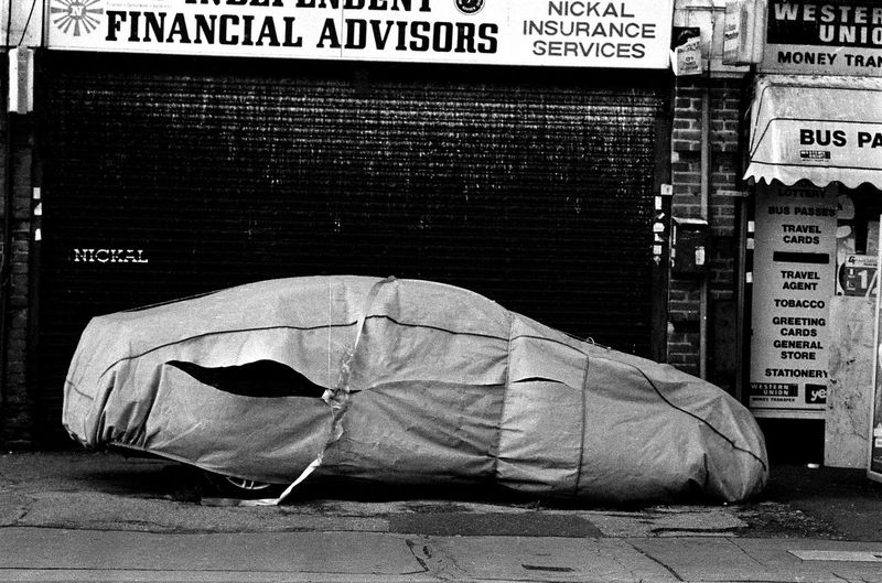 Car Under Wraps Architecture Black And White Collection  Brick Wall Building Exterior Built Structure Car Under Wraps City Cobblestone Communication Day Documentary Style Photography Graffiti Information Information Sign No People Non-western Script Outdoors Reportage Street Photos Taking Fotos Images Photographic Camera Lens Architectural Design Building Structual Support Detail Of Tower Block In Sunshine Blue Sk Sidewalk Street Text Wall Wall - Building Feature Western Script