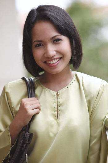 Cheerful Woman Standing Outdoors