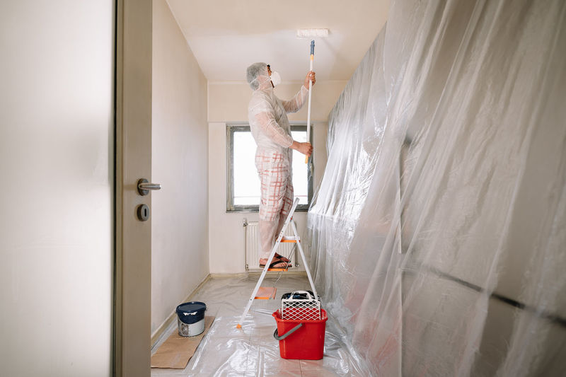 Man working in bathroom at home