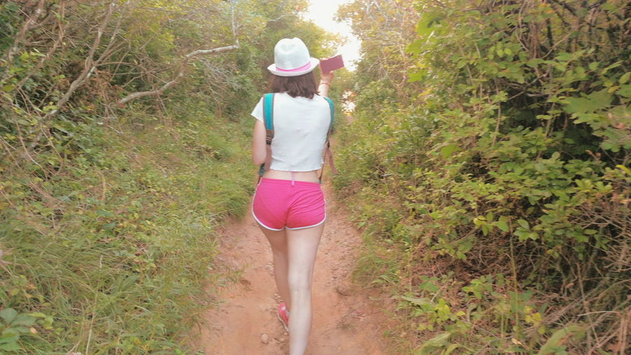 One Woman Only Rear View Hat Sun Hat Walking Grass Outdoors One Person Young Adult Full Length Real People Leisure Activity Young Women Nature Tree Green Hiking Adventure Summer Legs Girl The Week On EyeEm Forest Day Vacations