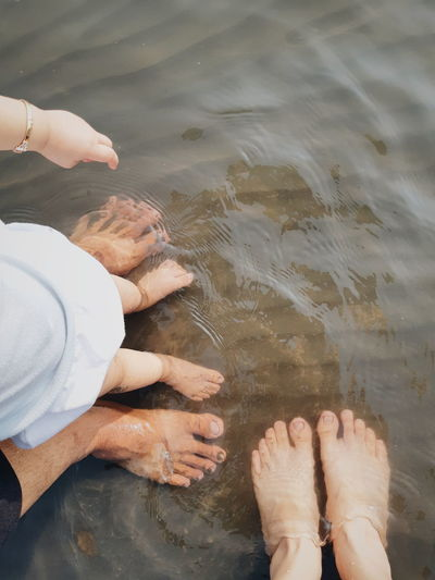 Low section of people in water