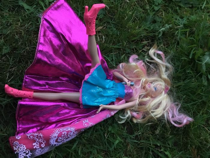 Bad night EyeEm Selects Doll Grass Plant Land Field Real People One Person Day Pink Color High Angle View Lifestyles Outdoors Purple Childhood