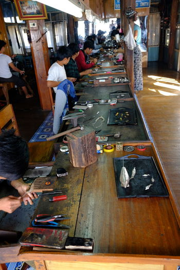 Gold & Silversmith Workshop, Inle Lake Arts And Crafts Composition Creativity Full Frame Goldsmith Incidental People Indoor Photography Inle Lake Jewellery Shop Manual Worker Marketplace Myanmar Occupation People Real People Shan State Shop Silversmith Silversmith's Trade Sunlight And Shade Tourism Tourist Attraction  Tourist Destination Workbench Workshop