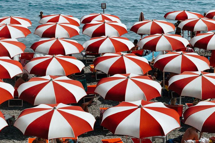 High angle view of red parasol at beach
