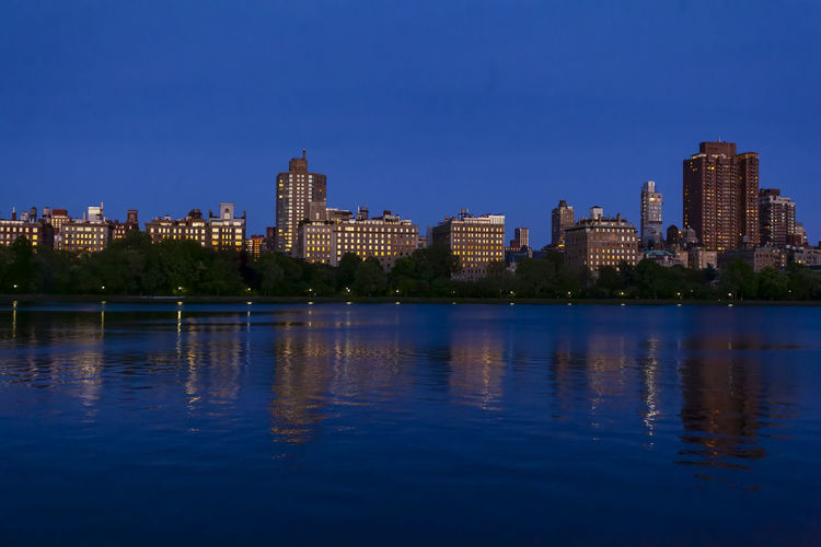 Central Park Reservoir At Sunset Facing 5th Avenue Central Park Reservoir Urban Scenic Reflections Cityscape Urban Skyline