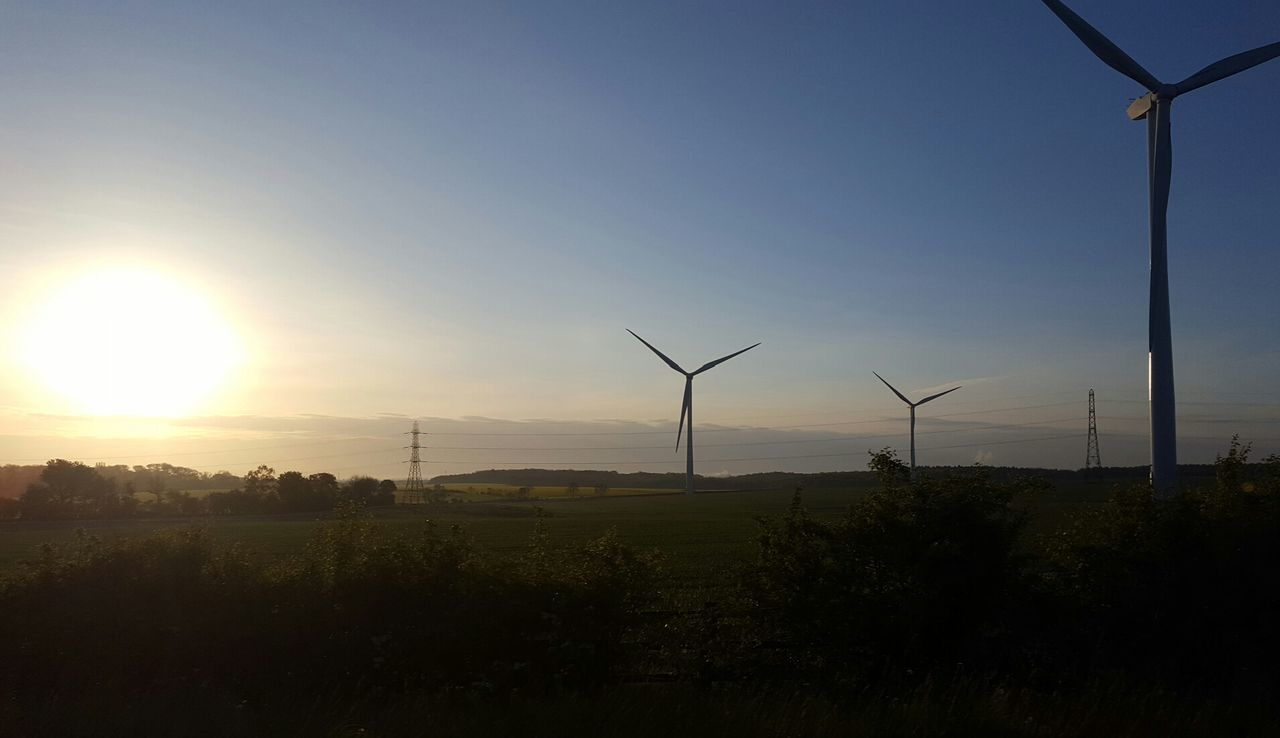 wind turbine, alternative energy, environmental conservation, wind power, renewable energy, fuel and power generation, windmill, industrial windmill, sunset, field, nature, rural scene, traditional windmill, outdoors, no people, beauty in nature, sky, landscape, sun, tree, scenics, technology, day